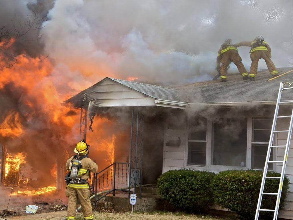 Smoke-fire-damage-restoration-house-on-fire--firefighter