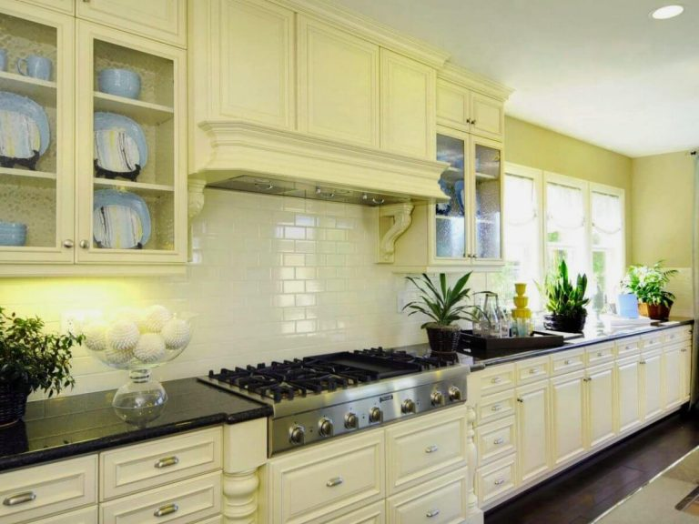 kitchen backsplash with white decoration and ceramic tiles