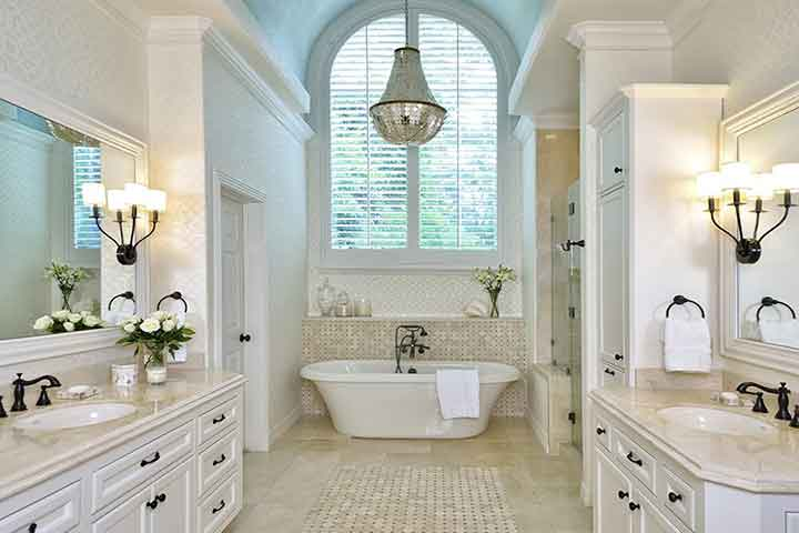Bathroom remodeling with blue barrel vault ceiling and capiz shell chandelier